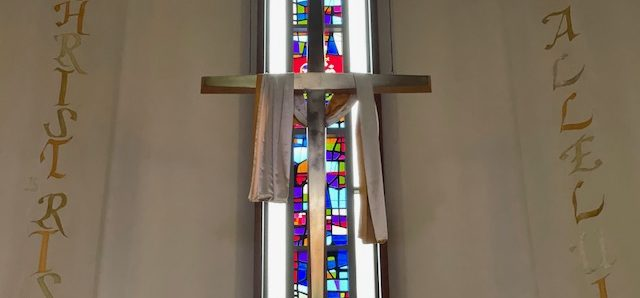 hanging cross with draped fabric